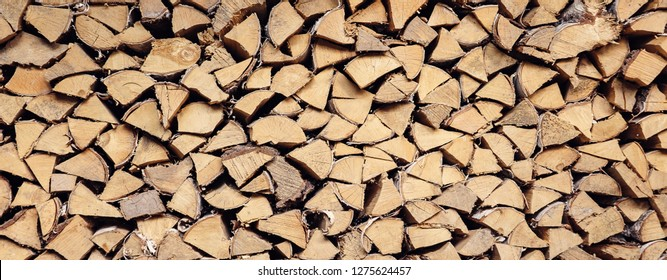 wall firewood, Background of dry chopped firewood logs in a pile - Image