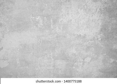 Wall fragment with scratches and cracks. Black and white textured weathered gray color handmade surface for background.