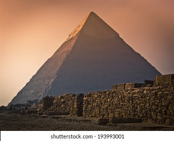 Wall in front of the great pyramid of Giza in Egypt during sandstorm.