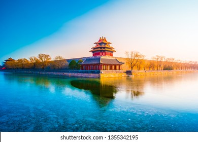 The wall and frozen moat of the Forbidden City at sunset. Beijing, China.