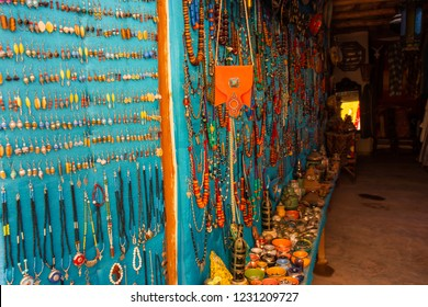 Wall full of colorful natural wooden jewelry and ethnic jewelry in the Medina of Marrakech, Morocco.
