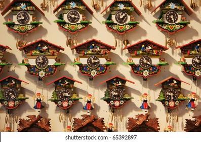 Wall full of cuckoo clocks