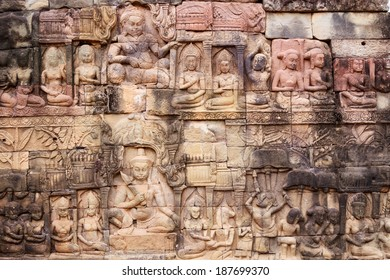 The wall full of reliefs: brahma, vishnu, shiva, apsara...