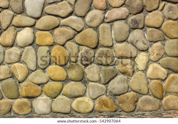 wall of gold and black shale, colorful wild natural stone. very beautiful close-up