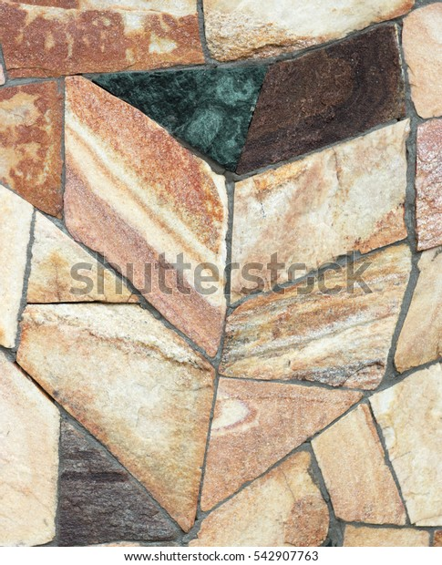 wall of gold and black shale, colorful wild natural stone. very beautiful stone wall