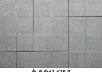 Wall grey tiles background.