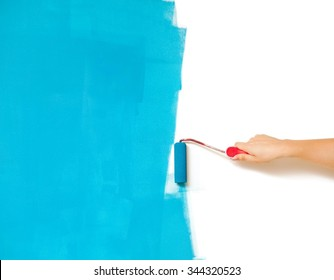 Wall half painted in blue.