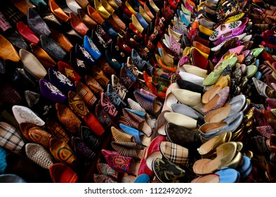 da8599ba2aa8 Wall of hand made traditional Moroccan shoes on a in a local markets shop  in Marrakech