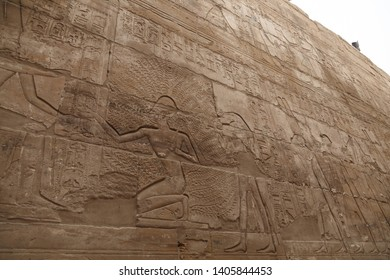 Wall with hieroglyphs of Karnak Temple in Luxor, Egypt. The temple complex at Karnak includes many ancient chapels, temples, monuments and columns of the ancient Egyptian civilization