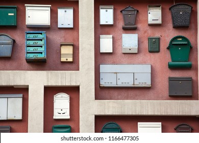 The wall of the house, decorated with a lot of mailboxes