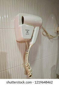 The wall hung type hair dryer in a bathroom.