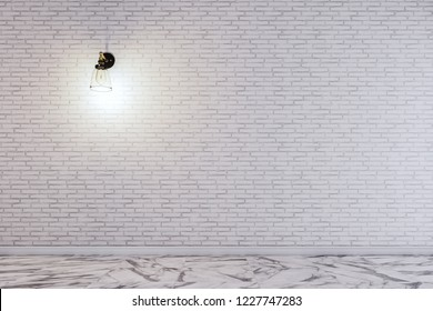The wall lamp on the white brick wall. working space