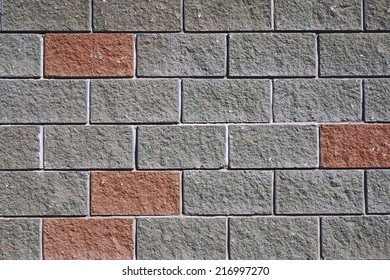 The wall of the large gray and red rectangular stones as background