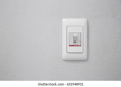 wall light switch in the on position