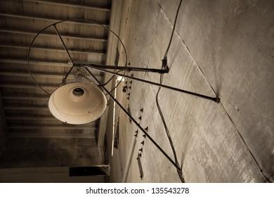 Wall lighting fixture inside an old gold dredge