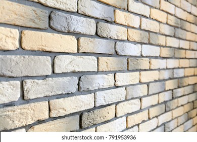 Wall with loft brick facing in yellow, white and gray