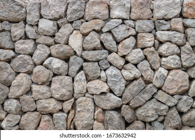 Wall made of bright stones without mortar