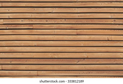 Wall made of brown wooden slats for background or texture