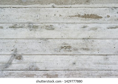 Wall Made of Concrete with Wood Texture / Texture of Wooden Formwork on The Concrete Wall