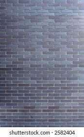 The wall made of dark clinker bricks