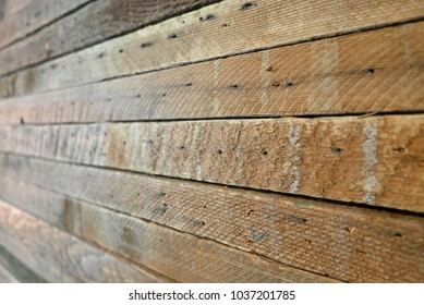 Wall made of reclaimed wooden planks
