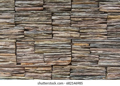 Wall made of stacked rock slates
