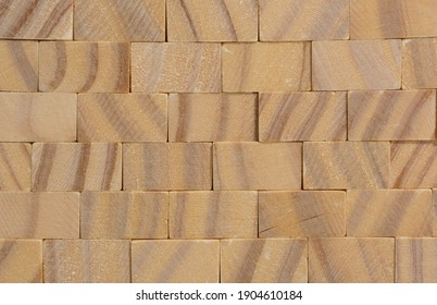 wall made of wooden cubes. use as background, background texture. copy space.
