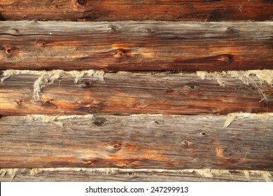 Wall made of wooden logs close up. Retro rural background.