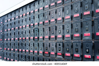A wall of metallic mailboxes near the post office.