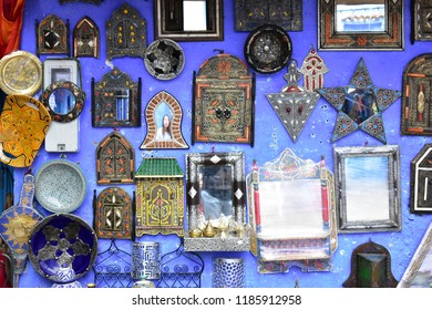 Wall of mirrors for sale at a marketplace in Chefchaouen