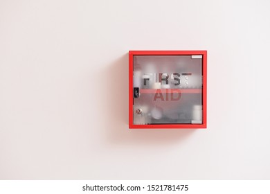 Wall mounted first aid kit on light background