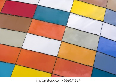Wall with multicolored tiles, background