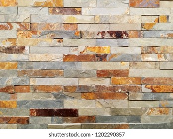 Wall of natural stones, wall texture background