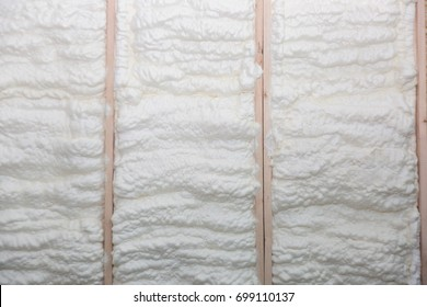 The wall of a new wooden house in foam for insulation and heat