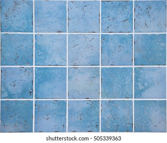 Wall of ocean blue colored ceramic tiles in vintage style. Kitchen decoration. Dimension of square is 10 x 10 cm.