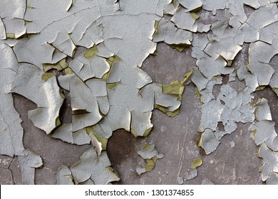 A wall with an old, broken paint