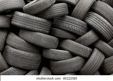 Wall of old car tires background, full frame