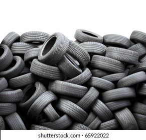 Wall of old car tires on white background