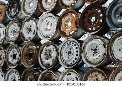 Wall of old car wheels