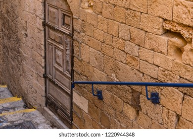 Wall with an old decorative door