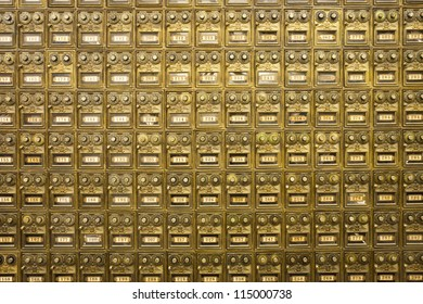 A wall of old fashioned brass post office boxes in Carmel, California.