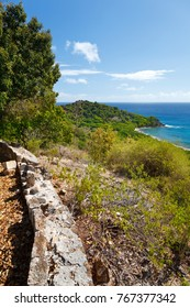 Wall of an old Fort near Black's Point in Antigua. View over Falmouth Harbor entrance.