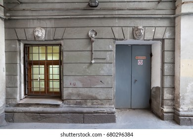 The wall of the old house with door and window in St. Petersburg, Russia