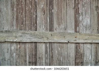 Wall of old plank wood of barn.Antique wooden vintage door texture or background.Copy space for text.Workspace empty blank to word.