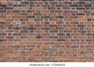 Wall of old red bricks