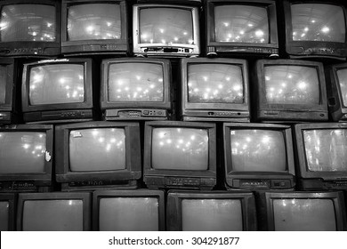 wall of old vintage tube televisions background