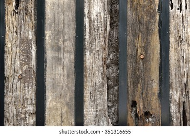 Wall with old wooden railway sleepers