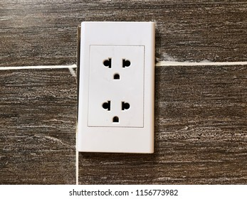 A wall outlet, Electric holes, plug points, sockets