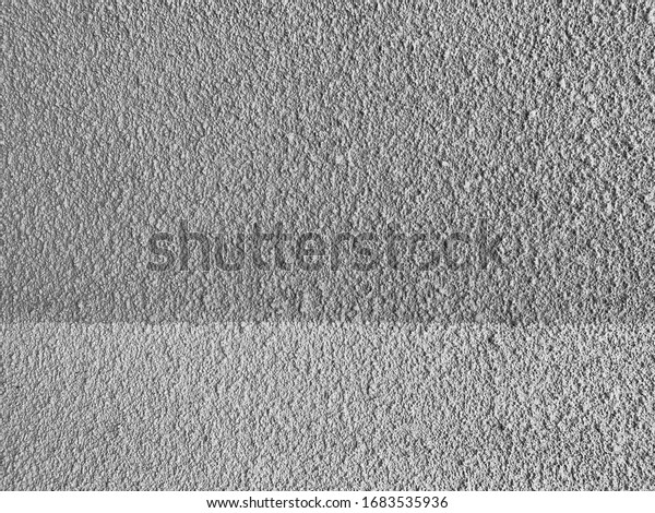 Wall painted gray and white, close up.