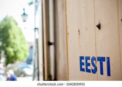 "Wall with Painted Sign Reading ""Estonia"" in Estonian Language"